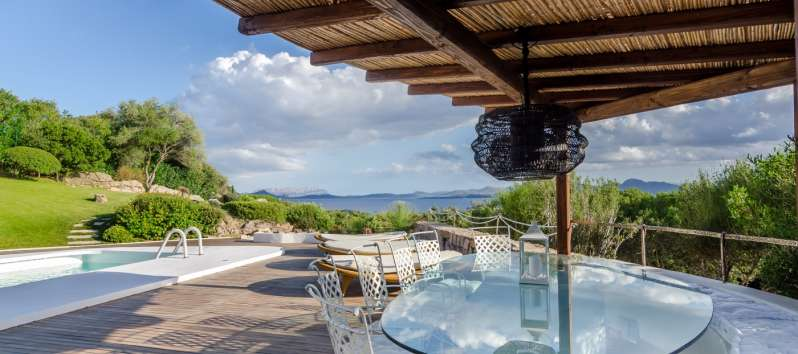 gazebo with glass table in the villa with swimming pool in Costa Smeralda