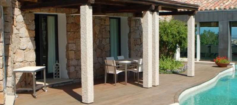 Stone Villa's porch with teak flooring by the pool