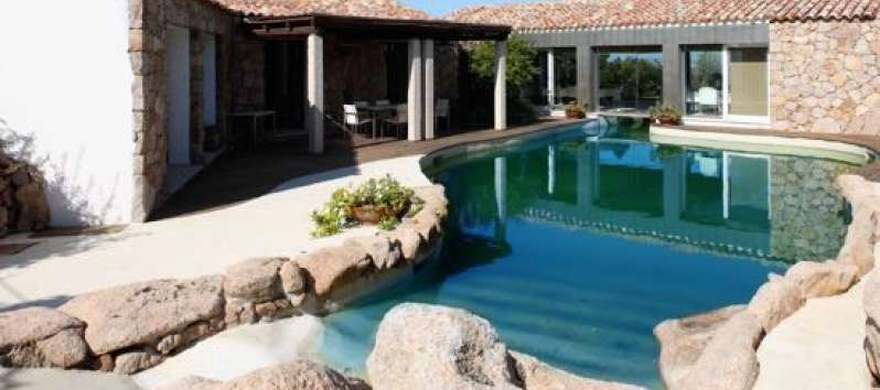 swimming pool with porch in the villa in Sardinia