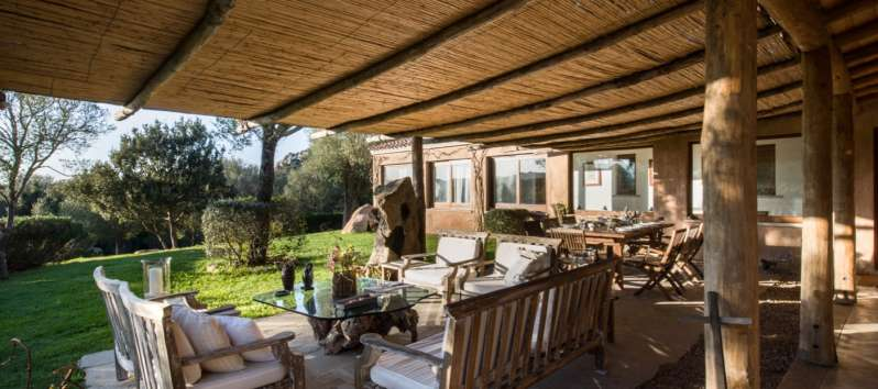 outdoor lounge with gazebo in the villa with swimming pool in Sardinia