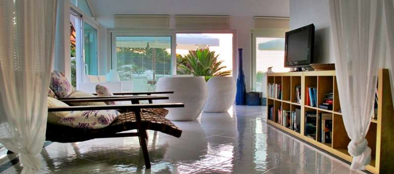 living room with table in the villa with pool in Castelsardo