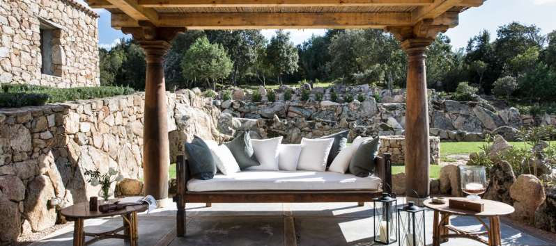 gazebo with sofa and armchairs in the villa in Sardinia