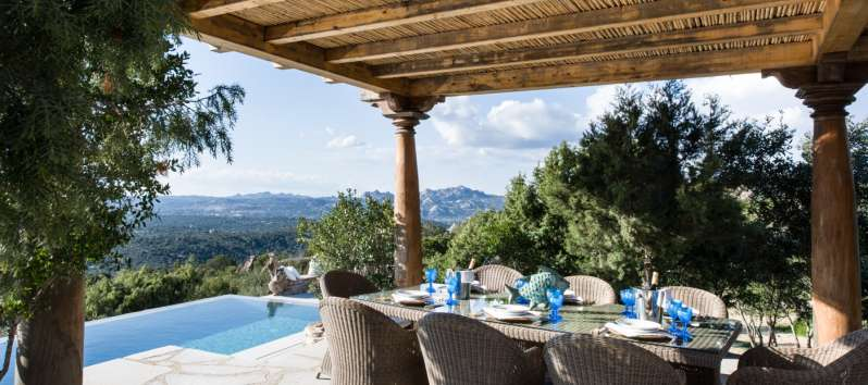 dining area outside the villa with swimming pool in Sardinia