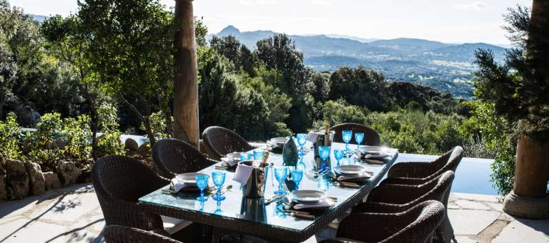 dining area with a panoramic view in the villa in Sardinia