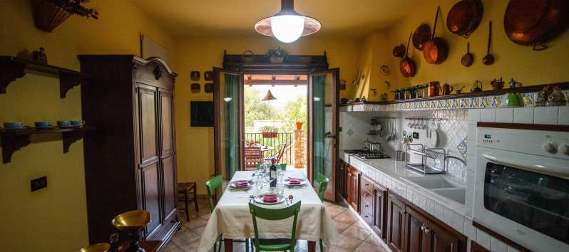 kitchen with table in the villa with pool in Cinisi