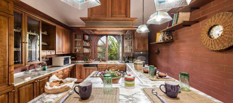 kitchen with table in the villa with pool in Palermo