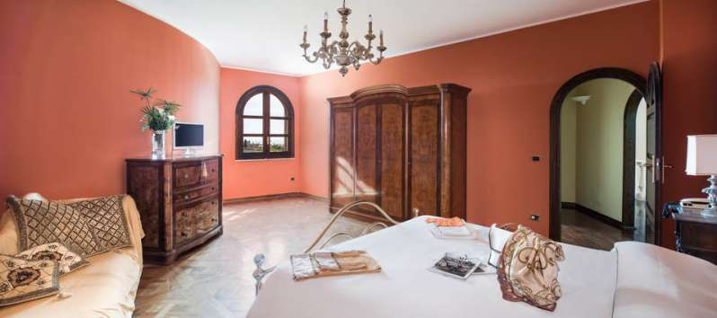 bedroom with wooden wardrobe in the villa with pool in Palermo