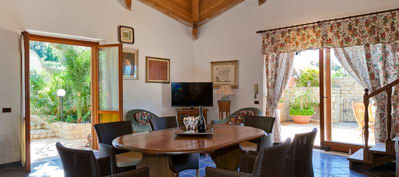 table in the living room of the villa with swimming pool in Trapani