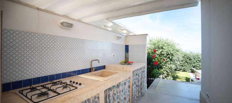 kitchen outside the villa with pool in Balestrate