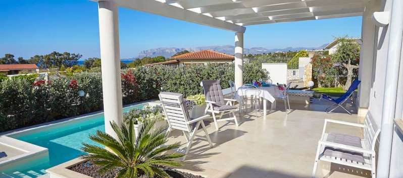villa with pool and deckchairs in Balestrate in Sicily