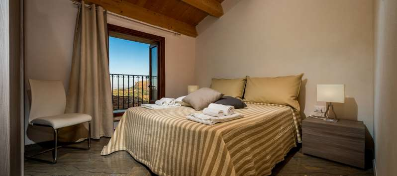 double bedroom with balcony in the villa with swimming pool in Scopello