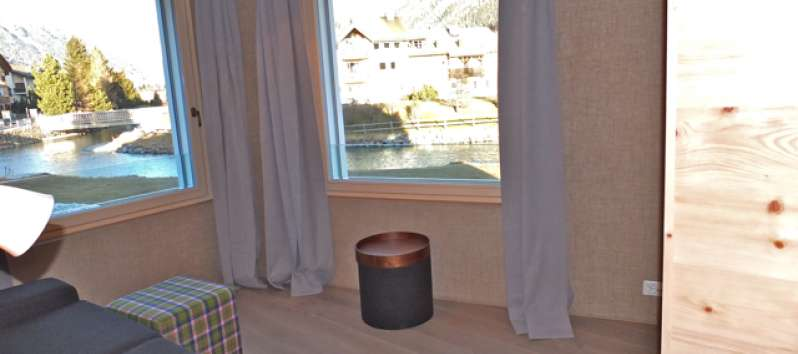 windows with panoramic views in the apartment in the Engandine area