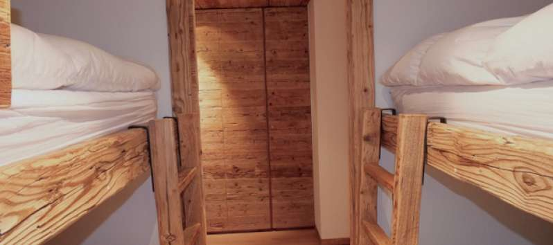 room with two bunk beds in the apartment in Canton Graubünden