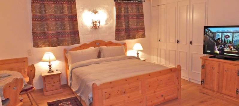Sleeping area comfortable wooden double bed