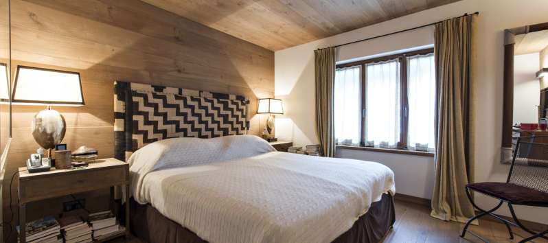 Chalet Surlej's double bedroom with upholstered bed