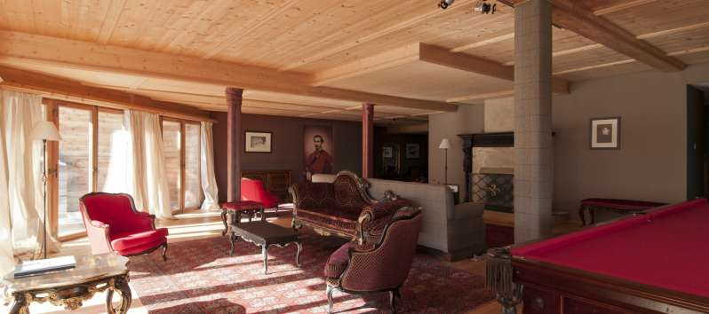 living room with sofa in the villa in St. Moritz