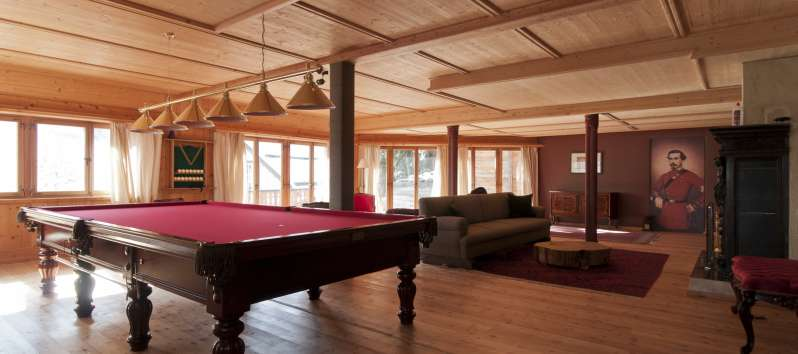 lounge with pool table in the villa in St. Moritz