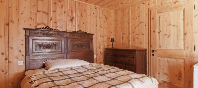 wooden bedroom in the villa in St. Moritz