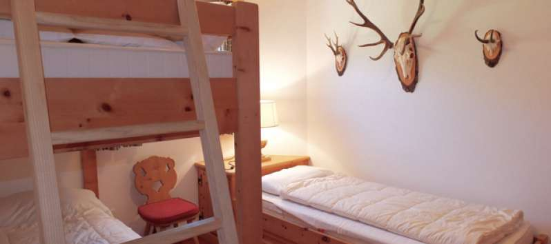 bedroom with bunk bed in the apartment in Saint Moritz