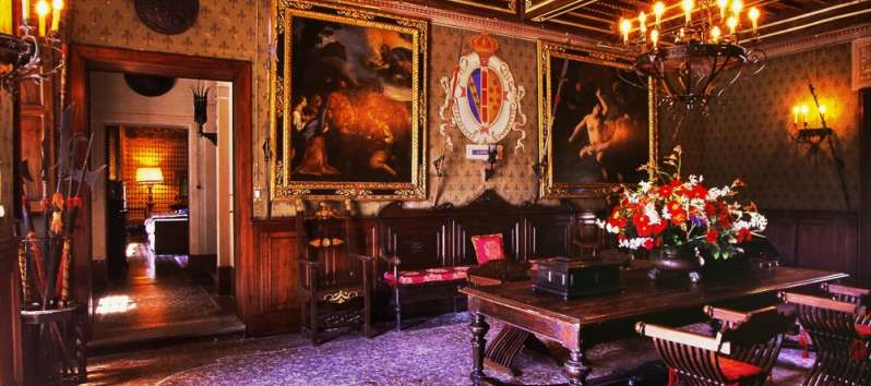 Castello Hedera living area full of antiques and works of art