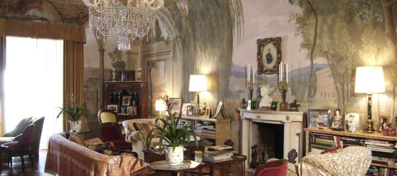 The Castle sumptuous living room with frescoes and antiques