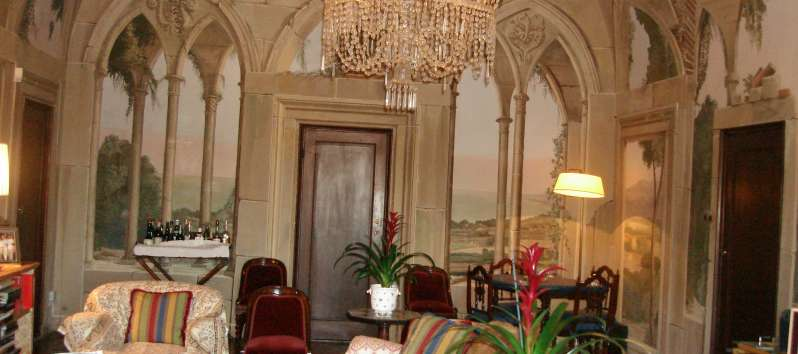 The Castle view of the living area with beautifully frescoed walls and ceilings