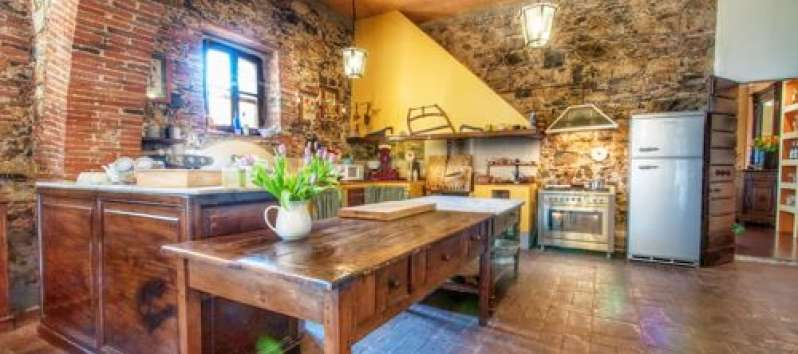 Villa Agreste original stone walls and bricks in the fully equipped kitchen