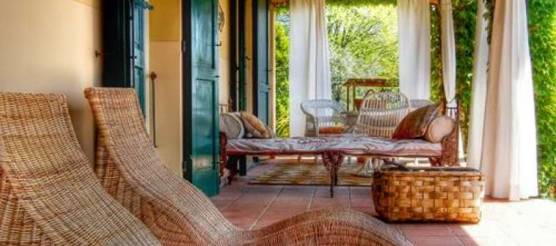 Villa Agreste rustic porch with chaise lounges