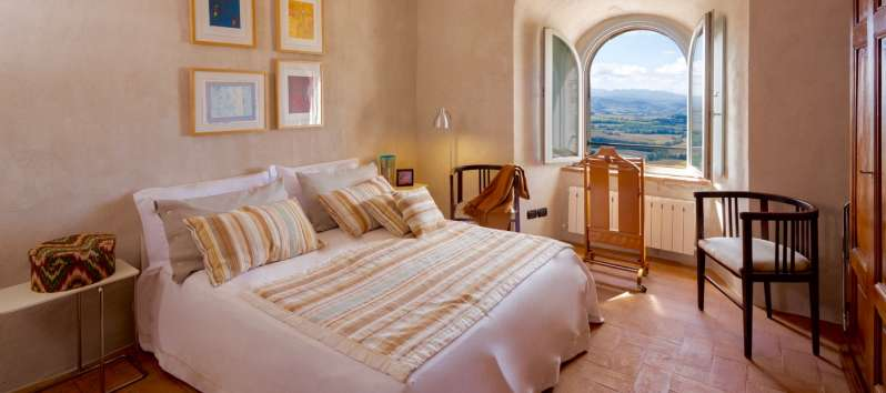 double bedroom with panoramic window in the villa of Perugia
